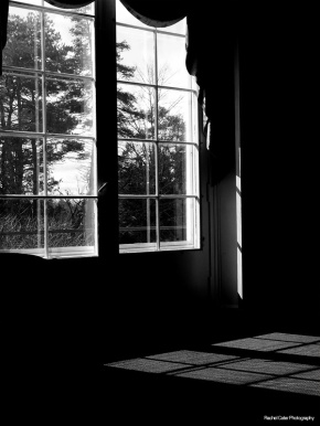 black and white photograph of light spilling through a window