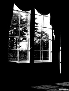 B&W photo of light through a window