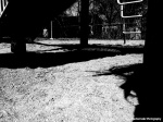 Black and white photograph playground with shadows and shapes in Toronto
