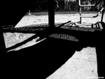 Black and white photograph playground with shapes and shadows in Toronto