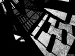 Black and white photograph Shadows under a playground in Toronto