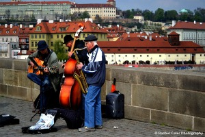 Older men playing instruments on Charles Bridge Rachel Cater Photography