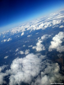 View of cloud and land from Plane Rachel Cater Photography