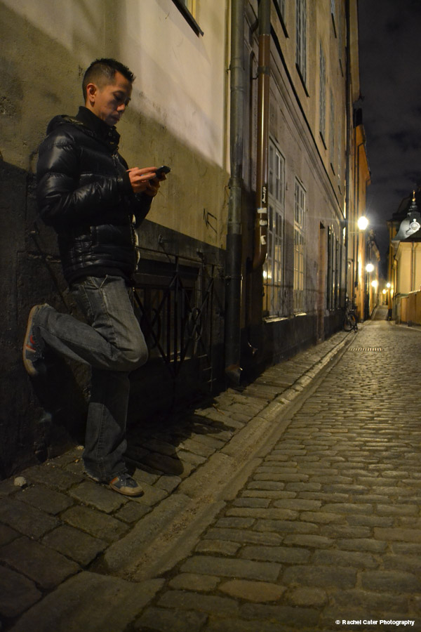 Man leaning against a walll in old town Sweden Rachel Cater Photography