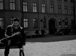 Man sitting on bench in stockholm Rachel Cater Photography