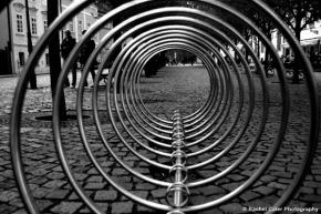 View through a bike rack Rachel Cater Photography