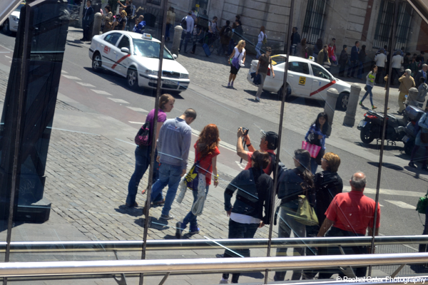 Reflections in of tourists in Mirrored Windows Madrid Rachel Cater Photography