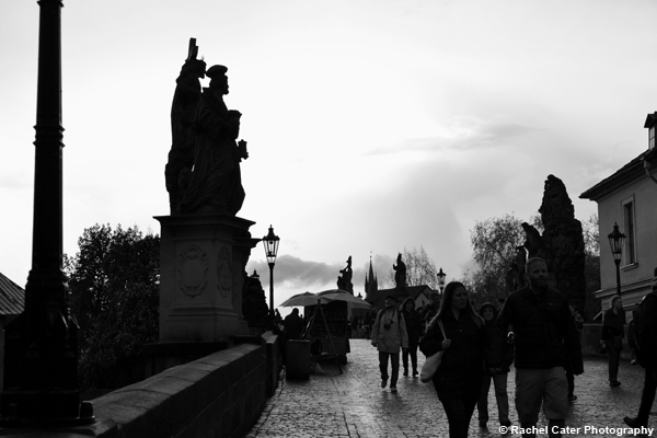 Walking on Charles Bridge in Prague Rachel Cater Photography