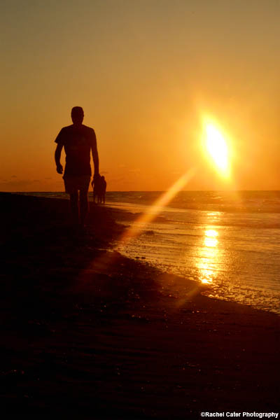 man-walking-on-beach-during-sunset-in-cuba-rachel-cater-photography