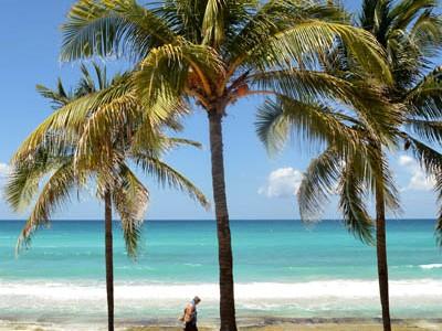 man-walking-on-beach-in-cuba-rachel-cater-photography